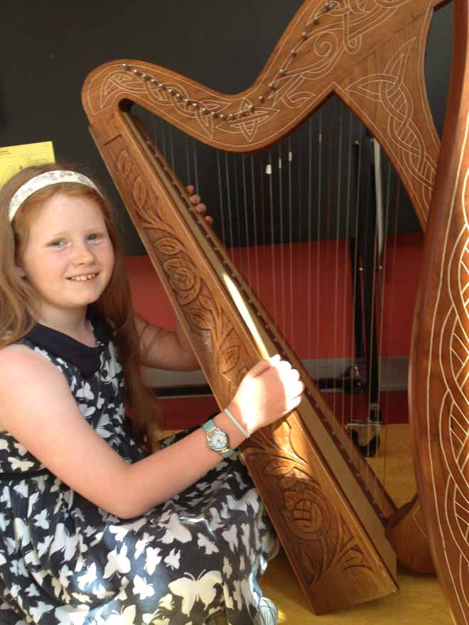 Enjoying the Harp at Ceol na Coille Summer School 2013