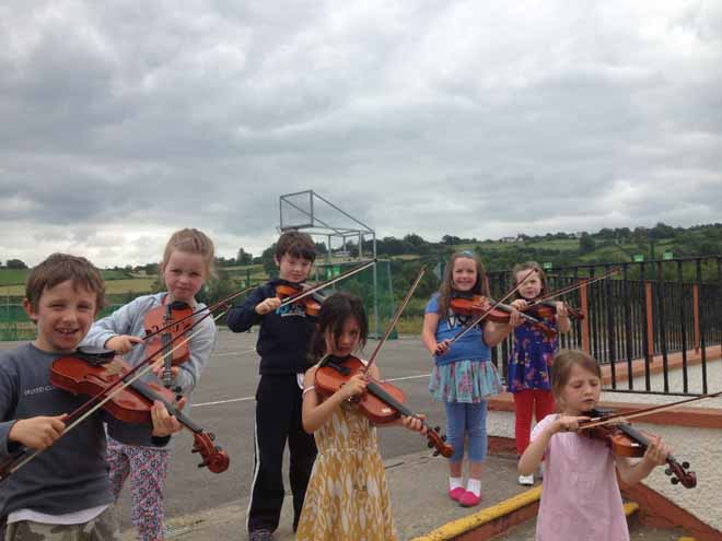 Some young musicians at the Introduction to Irish Music Class at this years Ceol na Coille Summer School